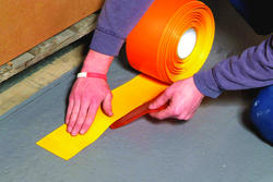 "Rust-Oleum® Industrial Flooring 4"" Black and Yellow Heavy-Duty Line Marking Tape - 98' Roll"